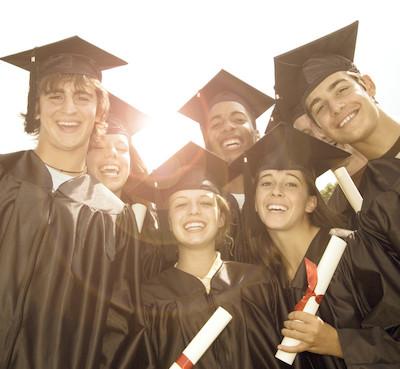 Smiling Graduates with Diplomas